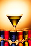 Multi-coloured shots and martini glass Stock Images