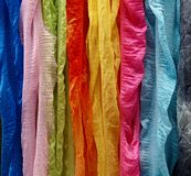 Multi coloured silk scarfs - background resources Stock Photos