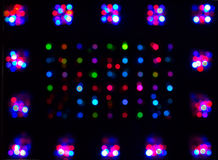 Multi-coloured spots. On a black background Royalty Free Stock Photo