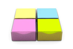 Multi Coloured Sticky Notes Stickers with a Holder Cases. On a white background Royalty Free Stock Photography