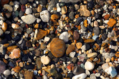 Stones under water background. Multi coloured stones background picture stock photography