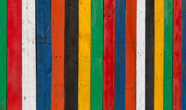 Multi-coloured stripped wooden fence royalty free stock images