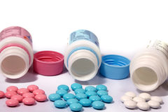 Multi-coloured tablets. Red, dark blue, white on a white background Royalty Free Stock Photos