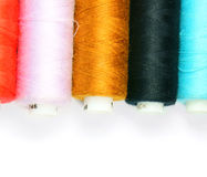 Multi-coloured threads. On a white background. Stock Image