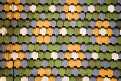 Multi-coloured tile Stock Images