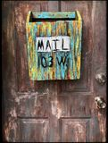 Multi-coloured Wooden Mailbox Mounted On Door Royalty Free Stock Image