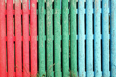 Multi coloured wooden stake fence Stock Photography