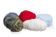 Multi-Coloured Wool on White Background. Multi-Coloured knitting wool, white background royalty free stock image