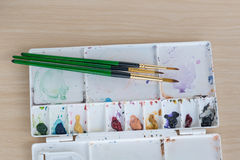 Multi colours paint tray on wood background Stock Photo