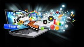 Multi computer portatile del Internet di media con gli oggetti sul nero Fotografia Stock Libera da Diritti