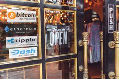 Multi Crypto Currencies welcome banner. With text `accepted here ` in front of door store, bitcoin, ethereum, ripple, dash coin royalty free stock images