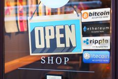 Multi Crypto Currencies welcome banner. With text `Accepted here ` in the front of store, bitcoin, ethereum, ripple, litecoin stock image