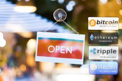 Multi Crypto Currencies welcome banner. With text `Accepted here ` in the front of store, bitcoin, ethereum, ripple, litecoin royalty free stock photography