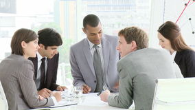 Multi Cultural business meeting with people interacting Royalty Free Stock Photos
