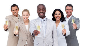 Multi-cultural business team drinking champagne. Portrait of multi-cultural business team drinking champagne against a white background Stock Photography