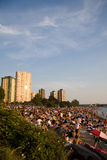 Multi-cultural crowd gathers at Sunset on English Bay, Vancouver Stock Photo