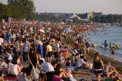 Multi-cultural crowd gathers at Sunset on English Bay, Vancouver Stock Image