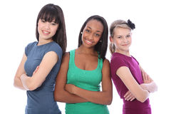 Multi cultural group teenage school girl friends. Three multi cultural teenage school student friends made up of mixed race african american, oriental Japanese Royalty Free Stock Image