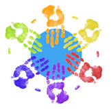 Multi - cultural team. Multi colored hands touching globe together Stock Photo