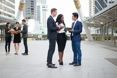Group of business people standing in the city and discussing ideas for business future. multi culture of business people, African,. Multi culture of business stock images