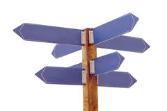 Multi direction signpost. Multidirectional wooden signpost with blank blue direction plates over white stock photo