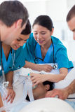Multi-ethic doctors resuscitating a patient Stock Photos