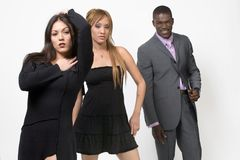 Multi-ethnic adults. Multi-ethnic group of adults, two women and one man, posing for camera Stock Image