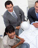 Multi-ethnic architects working with blueprints Royalty Free Stock Photos