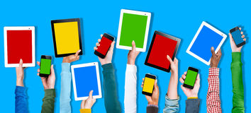Multi Ethnic Arm Raised Unity Togetherness Digital Device Concep. T Royalty Free Stock Images