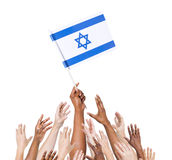 Multi-Ethnic Arms Raised for the Flag of Israel Stock Images