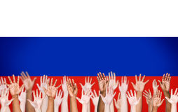 Multi-Ethnic Arms Raised With Flag Of Russia Royalty Free Stock Photography