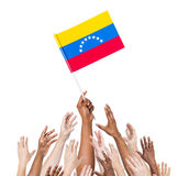 Multi-Ethnic Arms Raised for the Flag of Venezuela Royalty Free Stock Photo