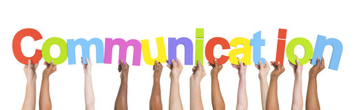 Multi-Ethnic Arms Raised Holding Word Communication Stock Photo