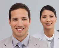 Multi-ethnic business associates in a line Royalty Free Stock Image