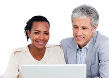 Multi-ethnic business co-workers using a laptop Royalty Free Stock Image