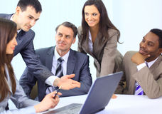 Multi ethnic business executives. At a meeting discussing a work stock image