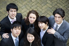 Multi ethnic business group looking up Stock Photos