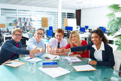 Multi ethnic business meeting thumbs up gesture Royalty Free Stock Image
