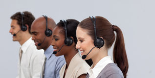Multi-ethnic business partners in a call center Royalty Free Stock Photo