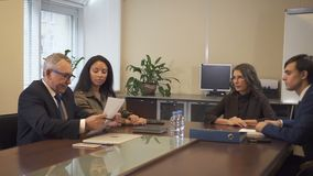 Multi ethnic business partners on negotiations in office boardroom. stock footage