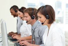 Multi-ethnic business people in a call center Royalty Free Stock Photo