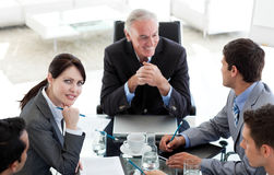 Multi-ethnic business people at a conference table Royalty Free Stock Photography