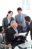 Multi-ethnic business people discussing a contract Stock Photography