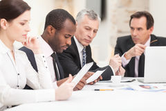 Multi ethnic business people discussing work. Team of multi ethnic business people discussing work Stock Photo