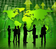 Multi-Ethnic Business People with Global Economic. Group Of Multi-Ethnic Business People Working On A Global Economic Recovery Themed Background Royalty Free Stock Photos