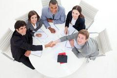 Multi-ethnic business people greeting each other. In a meeting stock photos