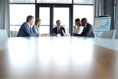 Multi-ethnic business people having discussion at conference table in office royalty free stock images