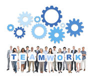 Multi-Ethnic Business People Holding Cardboards. Group of Multi-Ethnic Business People Holding Cardboards Forming Teamwork Stock Images