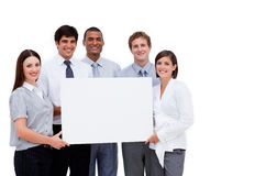 Multi-ethnic business people holding a white card Royalty Free Stock Photo