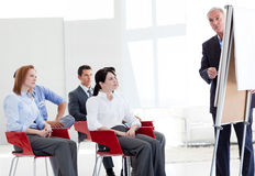 Multi-ethnic business people at a seminar Stock Photos